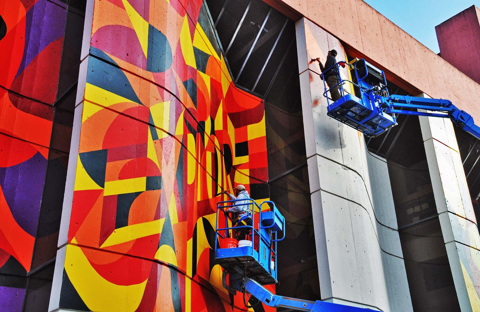 Graffiti Artists work on Large Scale Public Art